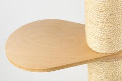 The birch wood step on this minimalist and modern luxury cat tree from Tuft + Paw.