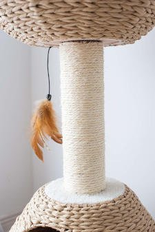 The central scratching post that supports the top bed on this wicker style paper rope cat tree.